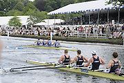 Henley, Great Britain.  Henley Royal Regatta. M4+, London Rowing Club 'A' [Bucks], lead Taurus Boat Club [Berks], as they pass the Grandstands, in the Semi-Final, of the Britannia Challenge Cup. River Thames Henley Reach.  Royal Regatta. River Thames Henley Reach.  Saturday  02/07/2011  [Mandatory Credit  Intersport Images] . HRR