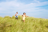 Couple Running through Meadow