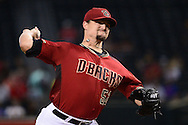 PHOENIX, AZ - AUGUST 03:  Zack Godley #52 of the Arizona Diamondbacks delivers a pitch during the first inning Washington Nationals at Chase Field on August 3, 2016 in Phoenix, Arizona.  (Photo by Jennifer Stewart/Getty Images)