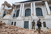 KATHMANDU, NEPAL - APRIL 26: (CHINA OUT)<br /> <br /> Two police soldiers walk out of a damaged building at Durbar Square on April 26, 2105 in Kathmandu, Nepal. A 8.1-magnitude earthquake struck Nepal on Saturday and the earthquake felt in southeast China\'s Tibet Autonomous Region which brought some houses into collapse. While another 7.1-magnitude earthquake hit the county again the following day afternoon. Chinese government sent out Sichuan Rescue Team, the only one national emergency medical rescue team who could settle camps above an altitude of 3500 meters, to Nepal to support local rescue work and international assistance were also sent to the disaster areas. The earthquake had caused at least 3218 people to death and parts of Chinese visitors were detained in Nepal by Monday morning.<br /> ©Exclusivepix Media