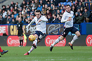 Zach Clough (Bolton Wanderers) takes a shot during the EFL Sky Bet League 1 match between Bolton Wanderers and Swindon Town at the Macron Stadium, Bolton, England on 14 January 2017. Photo by Mark P Doherty.