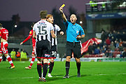 Yellow card for Grimsby Town midfielder Harry Clifton during the EFL Sky Bet League 2 match between Grimsby Town FC and Crawley Town at Blundell Park, Grimsby, United Kingdom on 17 November 2018.