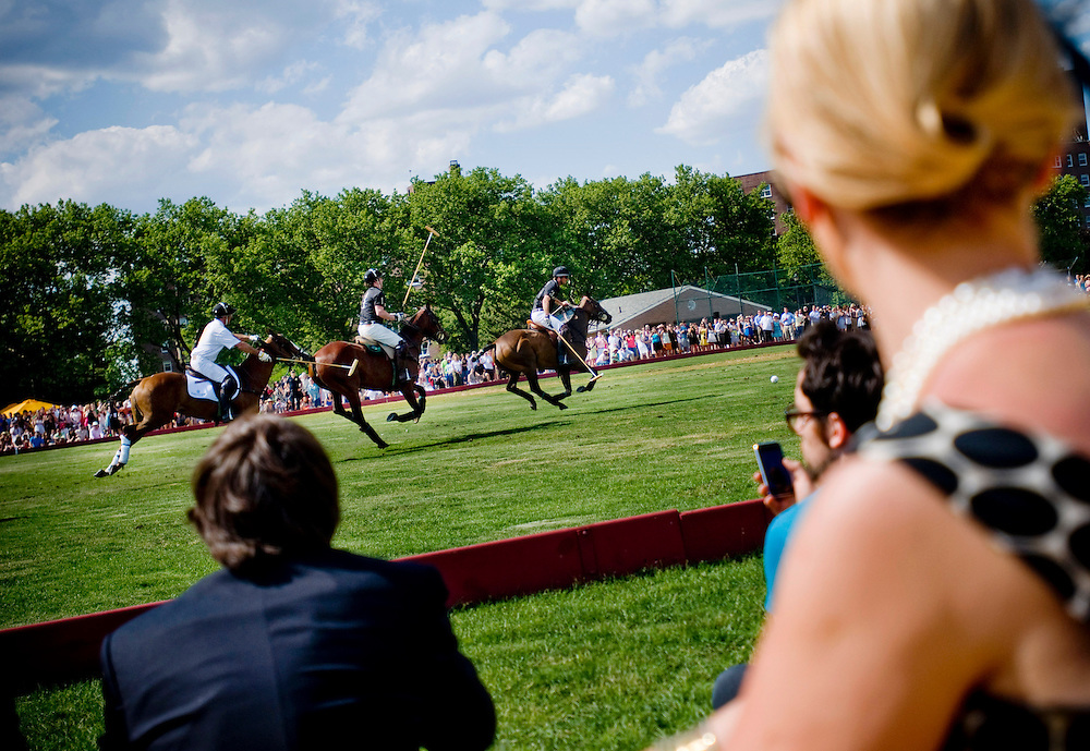 The 2009 Veuve Clicquot Manhattan Polo Classic on Governor's Island. Fan's watching the match.