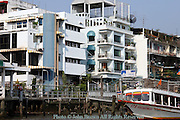 A boat is parked below a modern apartment building at Rachayongse stop 5 on the Chao Phraya river in Bangkok, Thailand. The Chao Phraya river is a major transportation artery for a vast network of river buses, cross-river ferries and water taxis, also known as longtails. More than 15 boat lines operate on the rivers and canals of the city, including commuter lines. Maenam (river) Chao Phraya, is a major river in Thailand, with its low alluvial plain forming the center of the country. It runs through Bangkok, the capital city, and then empties into the Gulf of Siam.