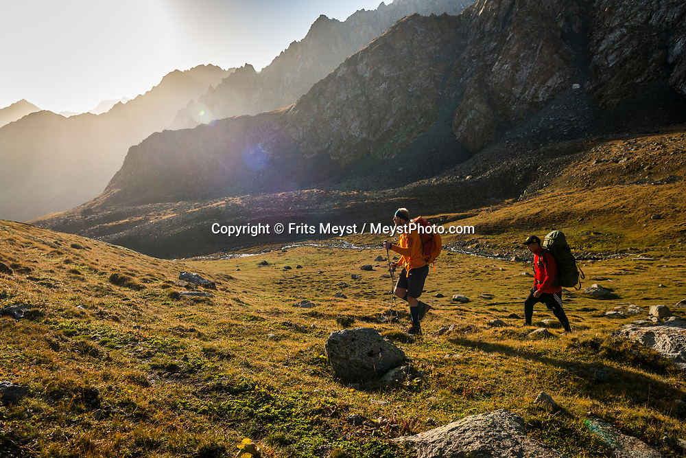 Karakol, Kyrgyzstan, September 2018. Hikers walk over the 3 day trek through the mountains behind Karakol.  The hike passes Sirota camp at 2800m, then continues past Ala Kul lake, climbs over the 3800m Ala Kul Pass, down Keldike valley and ending in the settlement of Altyn Arachan on the Ak Suu river. Kyrgyzstan is a rugged Central Asian country along the Silk Road, the ancient trade route between China and the Mediterranean. The Tian Shan mountains, which surround the old caravan route and dominate the country. Photo by Frits Meyst / MeystPhoto.com