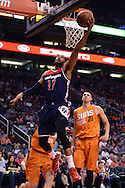 Apr 1, 2016; Phoenix, AZ, USA; Washington Wizards guard Garrett Temple (17) drives the ball to the basket in front of Phoenix Suns center Alex Len (21) in the first half at Talking Stick Resort Arena. Mandatory Credit: Jennifer Stewart-USA TODAY Sports
