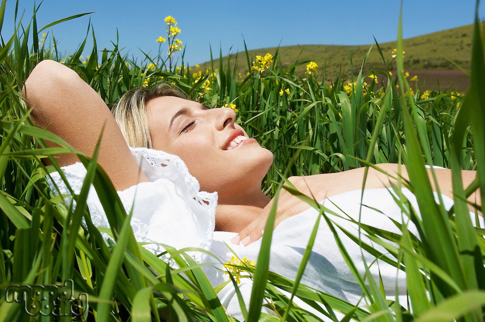 Woman Lying in mountain Meadow close up