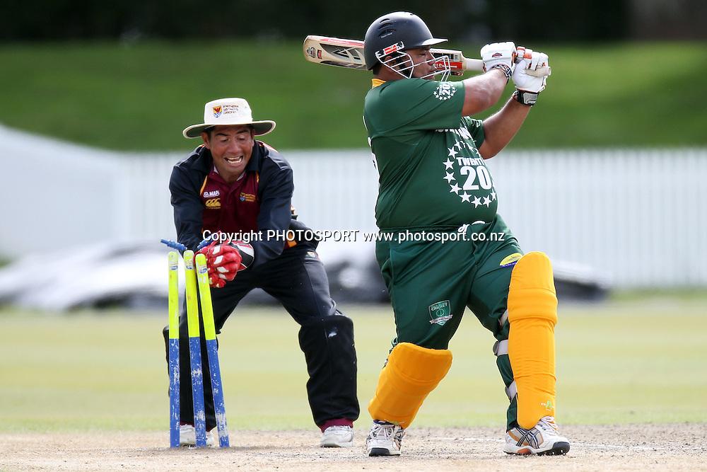 Apii Mamanu is stumped by player coach Graeme Stewart, Twenty 20 cricket, Northern Districts Maori v Cook Islands, Seddon Park, Hamilton. 4 April 2011. Photo: William Booth/photosport.co.nz