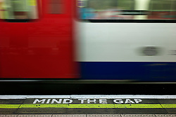 © Licensed to London News Pictures. 08/01/2013, London, UK. A 'Mind The Gap' sign is seen marked on the platform at Belsize Park underground station in London, Tuesday, Jan. 8, 2013. London Underground mark its 150 year anniversary on 9 January. In 1863 January 9 the world first underground train entered into public service. Photo credit : Sang Tan/LNP