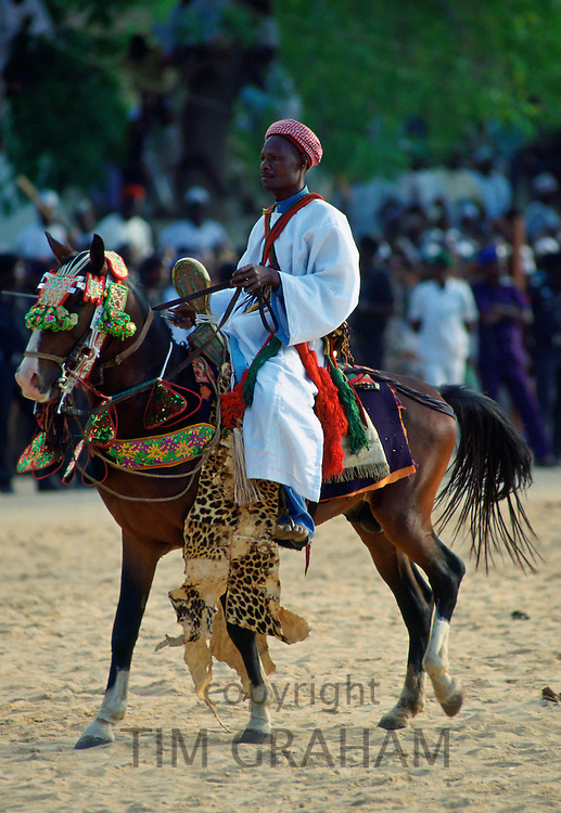 Man riding a decorated horse during a Durbar in Maiduguri, Nigeria