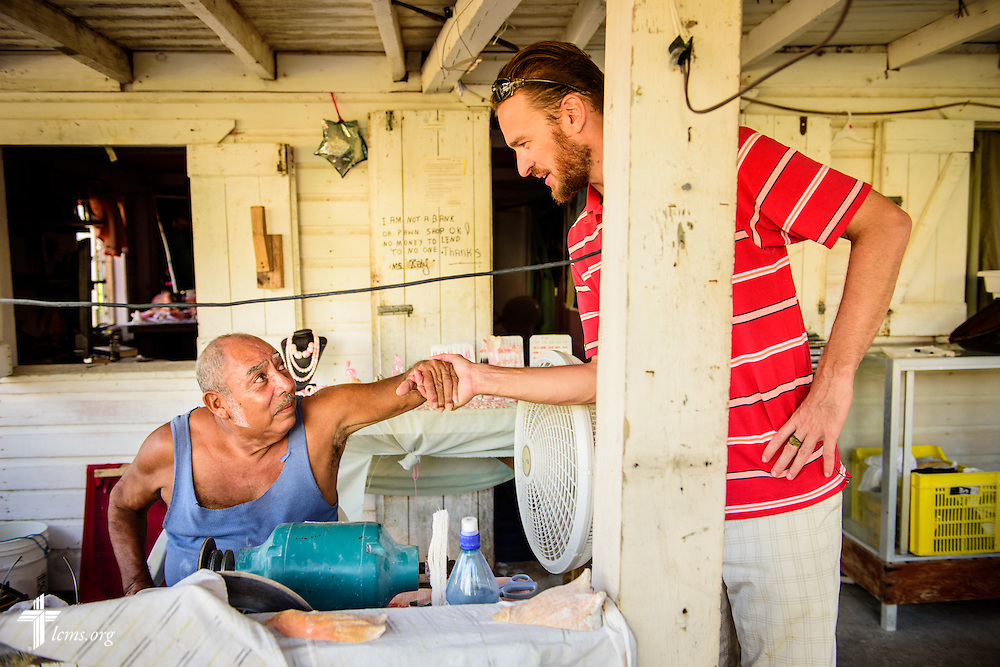 The Rev. Duane Meissner, career missionary to Belize, chats with local artist Orlando August in his shop on Wednesday, Sept. 28, 2016, in Placencia, Belize. LCMS Communications/Erik M. Lunsford