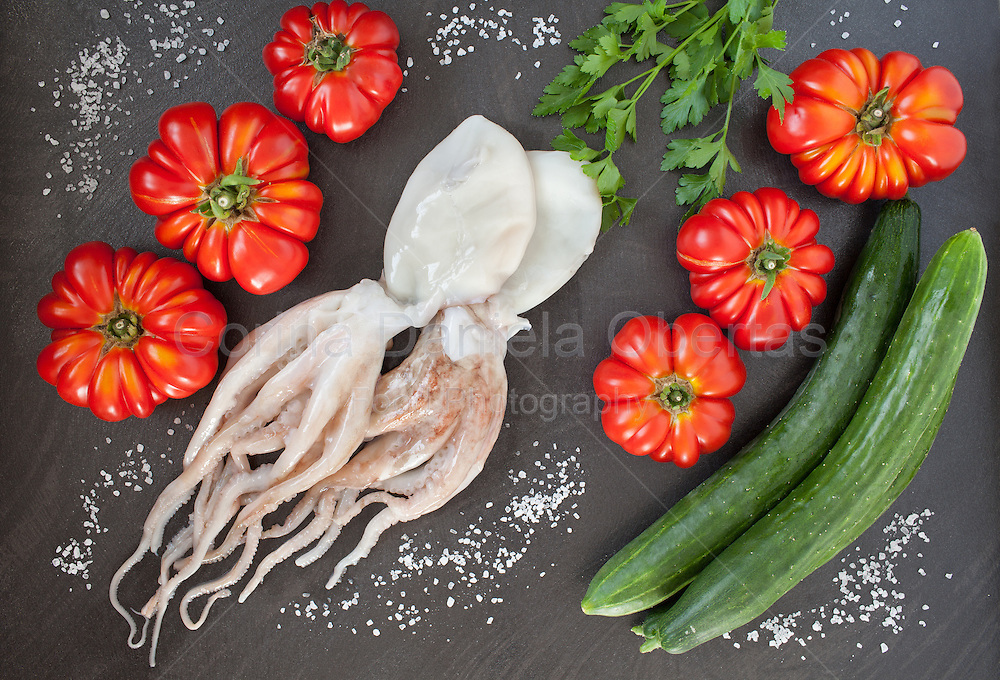 Healthy raw food for diet: cuttlefish, heirloom tomatoes and cucumbers. Flat lay photography.