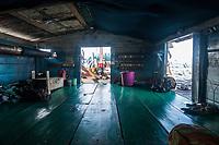 Life aboard a bagan, an Indonesia fishing platform, at Kwatisore village, Cenderawasih Bay, Western Papua, Indonesia.