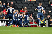 The Southend United players celebrate Southend United midfielder Stephen McLaughlin (11)  scoring (0-1) during the EFL Sky Bet League 1 match between Milton Keynes Dons and Southend United at stadium:mk, Milton Keynes, England on 22 October 2016. Photo by Dennis Goodwin.