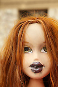 doll head with dust sticking to the lips