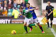 Lewis Stevenson (#16) of Hibernian FC skips past Daniel Candeias (#21) of Rangers FC during the Ladbrokes Scottish Premiership match between Hibernian and Rangers at Easter Road, Edinburgh, Scotland on 19 December 2018.