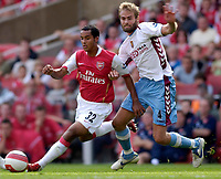 Photo: Daniel Hambury.<br />Arsenal v Aston Villa. The Barclays Premiership. 19/08/2006.<br />Arsenal's Theo Walcott and Villa's goal scorer Olof Melberg battle.