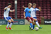 Scunthorpe United striker Paddy Madden (9) and Chesterfield FC defender Laurence Maguire (27) fight for the ball  during the EFL Sky Bet League 1 match between Scunthorpe United and Chesterfield at Glanford Park, Scunthorpe, England on 17 April 2017. Photo by Ian Lyall.