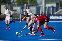 Holcombe's Steph Elliott is tackled by Jo Hunter of  Surbiton. Holcombe v Surbiton - Investec Women's Hockey League Final, Lee Valley Hockey & Tennis Centre, London, UK on 23 April 2017. Photo: Simon Parker