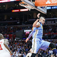 24 February 2016: Denver Nuggets forward Danilo Gallinari (8) dunks the ball past Los Angeles Clippers guard Jamal Crawford (11) on a fast break  during the Denver Nuggets 87-81 victory over the Los Angeles Clippers, at the Staples Center, Los Angeles, California, USA.