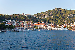 Hvar and its harbor as seen from a sea approach.  This Adriatic playground attracts celebrities and mega-yachts.