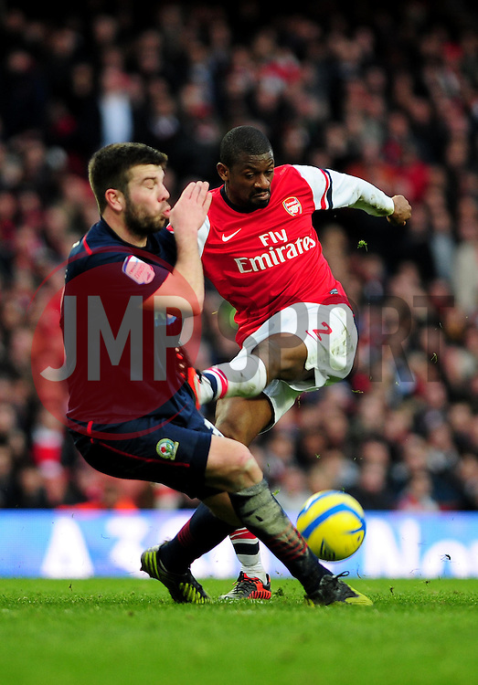 Arsenal's Abou Diaby sees his shot blocked by Blackburn Rovers' Grant Hanley - Photo mandatory by-line: Dougie Allward/JMP - Tel: Mobile: 07966 386802 16/02/2013 - SPORT - FOOTBALL - Emirates Stadium - London -  Arsenal V Blackburn Rovers - FA Cup - Fifth Round