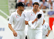 Photo © ANDREW FOSKER / SPORTZPICS 2008 - A smiling Andrew Freddie Flintoff (L) gives an equally happy Steve Harmison a word of encouragement during the latter's first session - England v South Africa - 07/08/08 - Fourth nPower Test Match -  Day 1 - The Brit Oval - London - UK - All rights reserved