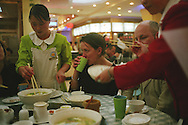 Susan Elderkin and Toby Litt, writers from the THINK UK WRITERS TRAIN, in a restaurant in Kunming. The Think UK China Writers Train is a project, in collaboration with the British Council, to take 4 UK writers/poets and 4 Chinese writers/poets around China by train visiting 6 major cities, in 17 days, to hold talks, seminars and readings of their work.