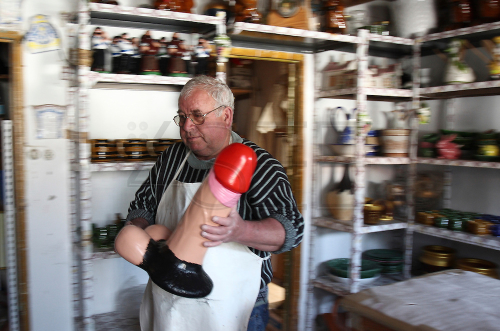 Francisco Silva with ceramic phallus created by himself in his atelier at Chao da Parada, in Caldas da Rainha city. He is one of the last artisans of this kind of erotic pottery  traditional to Caldas da Rainha, in the center region of Portugal.