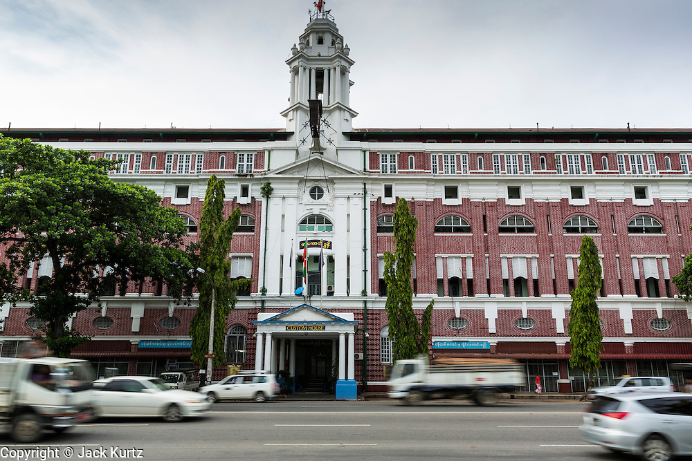 07 JUNE 2014 - YANGON, MYANMAR:  Myanmar Customs House on Strand Road is considered one of the better preserved colonial buildings in Yangon. It was built in 1915. Yangon has the highest concentration of colonial style buildings still standing in Asia. Efforts are being made to preserve the buildings but many are in poor condition and not salvageable.    PHOTO BY JACK KURTZ