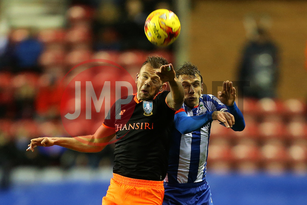Jordan Rhodes of Sheffield Wednesday challenges Stephen Warnock of Wigan Athletic - Mandatory by-line: Matt McNulty/JMP - 03/02/2017 - FOOTBALL - DW Stadium - Wigan, England - Wigan Athletic v Sheffield Wednesday - Sky Bet Championship