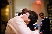 "Photo by Matt Roth.Assignment ID: 10137379A..Valerie Jarrett, senior advisor to President Obama hugs an acquaintance while leaving the Buffy and Bill Cafritz, Ann and Vernon Jordan, Vicki and Roger Sant inaugural ""Bi-Partisan Celebration"" at the Dolley Madison Ballroom at the Madison Hotel in Washington, D.C. on Monday, January 21, 2013."