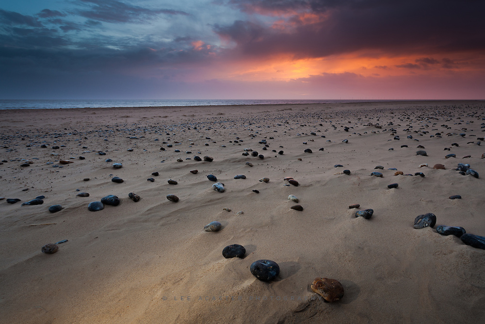 This is a similar shot to one uploaded a few weeks ago so ignore it if you've seen it before. Sunrise on the Norfolk coast, with a bit of off camera flash on the foreground. Just tidied up some of the processign a bit