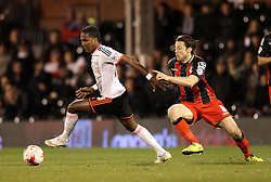 Fulham's Hugo Rodallega and Bournemouth's Harry Arter - Photo mandatory by-line: Robbie Stephenson/JMP - Mobile: 07966 386802 - 06/03/2015 - SPORT - Football - Fulham - Craven Cottage - Fulham v AFC Bournemouth - Sky Bet Championship