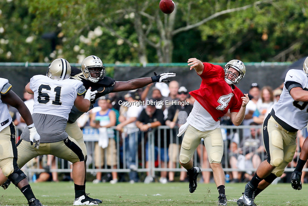 Aug 3, 2013; Metairie, LA, USA; New Orleans Saints quarterback Ryan Griffin (4) passes during a scrimmage at the team training facility. Mandatory Credit: Derick E. Hingle-USA TODAY Sports