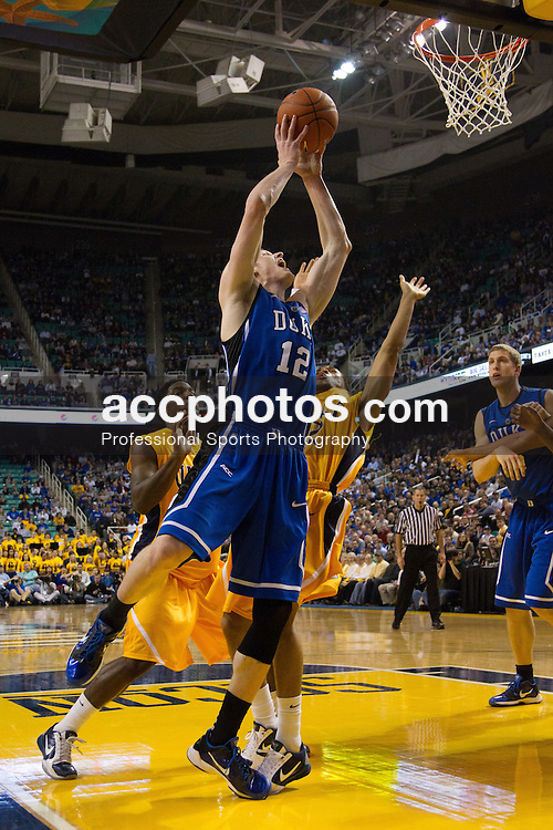 GREENSBORO, NC - DECEMBER 29: Kyle Singler #12 of the Duke Blue Devils shoots the ball while playing the UNC-Greensboro Spartans on December 29, 2010 at the Greensboro Coliseum in Greensboro, North Carolina. Duke won 108-62. (Photo by Peyton Williams/Getty Images) *** Local Caption *** Kyle Singler