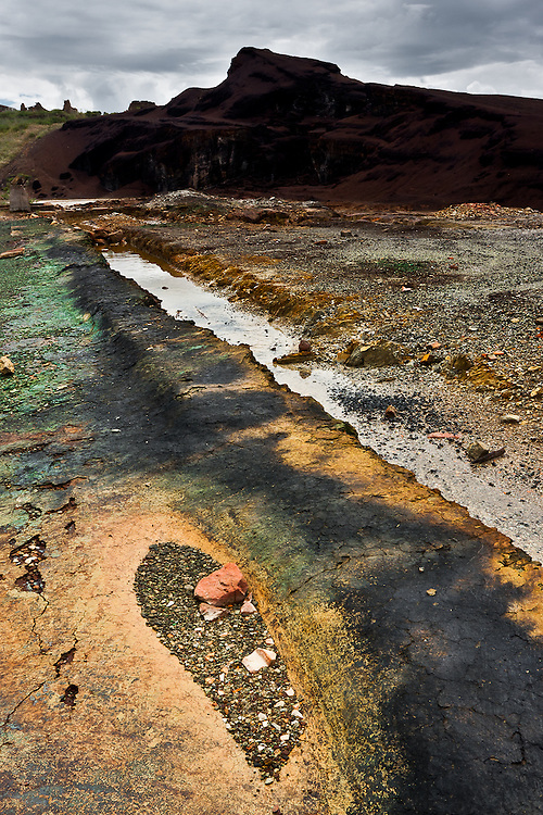 The ruins of the mining complex at Achada do Gamo take on strange colors, not unlike the colors at some volcanic sites