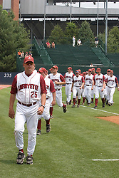 Lafayette Leopards Head Coach Joe Kinney (25) leads his team to the dugout for the start of a game against #23 Rutgers. The Lafayette Leopards fell to the the Rutgers Scarlet Knights 11-10 in their second game of the NCAA World Series Regional held at Davenport Field in Charlottesville, VA on June 2, 2007.