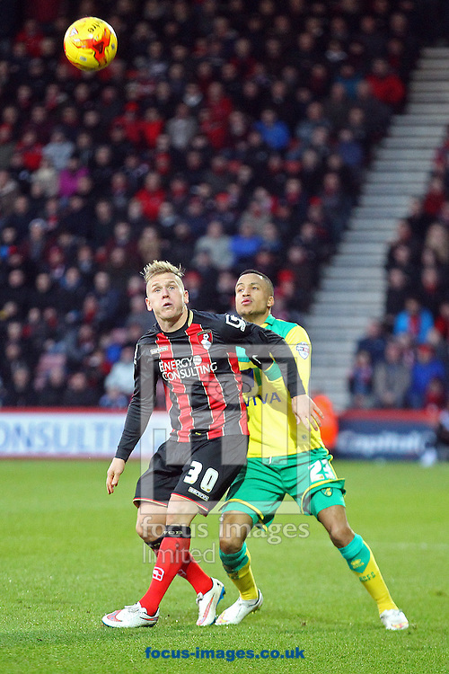 Nathan Redmond of Norwich and Matt Ritchie of Bournemouth in action during the match at the Goldsands Stadium, Bournemouth<br /> Picture by Paul Chesterton/Focus Images Ltd +44 7904 640267<br /> 10/01/2015