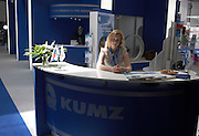 Young lady sits at the desk of aerospace alloys manufacturer Kumz during the Paris Air Show exhibition at Le Bourget