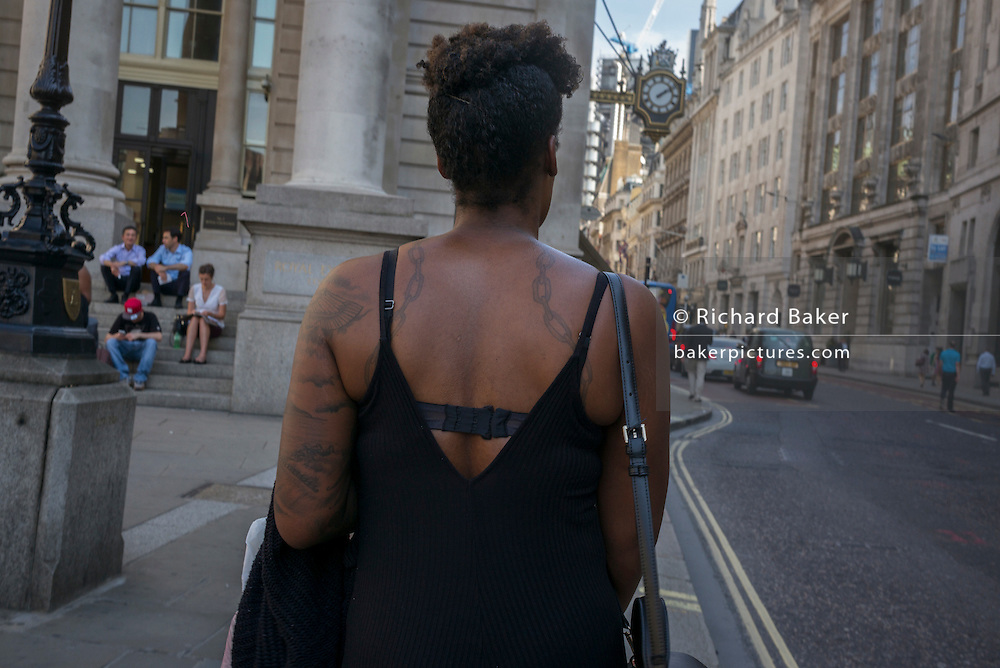 The rear of a woman and her tattoos during an unusual autumn heatwave on 13th September 2016, in the City of London, England.