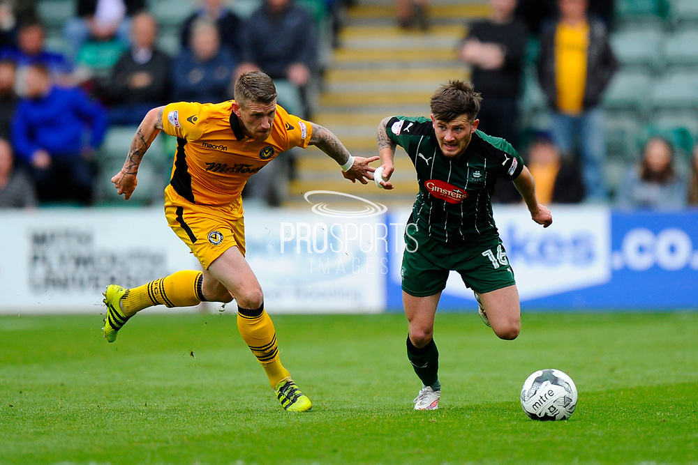 Matthew Kennedy (16) of Plymouth Argyle breaks away from Scot Bennett of (17) Newport County during the EFL Sky Bet League 2 match between Plymouth Argyle and Newport County at Home Park, Plymouth, England on 17 April 2017. Photo by Graham Hunt.