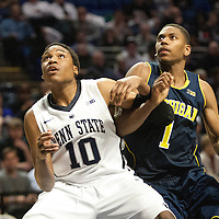 Penn State's Brandon Taylor (10) boxes out Michigan's Glenn Robinson III (1) in the second half of an NCAA basketball game in Unversity Park, Pa., Wedneday, February 27, 2013.