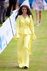 LIVERPOOL, ENGLAND - Friday, June 16, 2017: Model Cassielle Simms walks onto Centre Court during a fashion show during Day Two of the Liverpool Hope University International Tennis Tournament 2017 at the Liverpool Cricket Club. (Pic by David Rawcliffe/Propaganda)