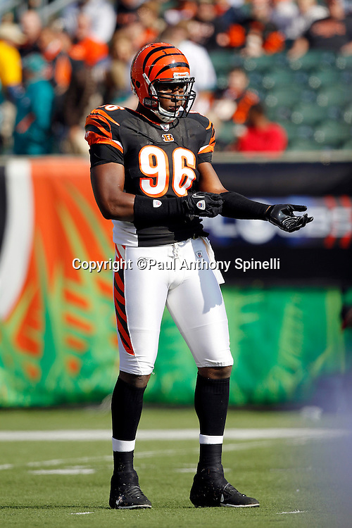 Cincinnati Bengals defensive end Carlos Dunlap (96) adjusts his wrist band during the NFL week 8 football game against the Miami Dolphins on Sunday, October 31, 2010 in Cincinnati, Ohio. The Dolphins won the game 22-14. (©Paul Anthony Spinelli)
