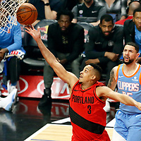 18 March 2018: Portland Trail Blazers guard CJ McCollum (3) goes for the layup past LA Clippers guard Austin Rivers (25) during the Portland Trail Blazers 122109 victory over the LA Clippers, at the Staples Center, Los Angeles, California, USA.