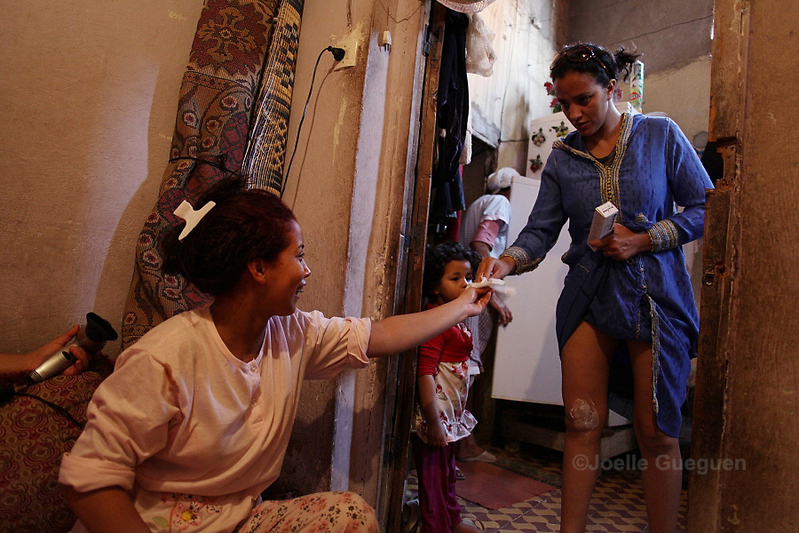 Rachida asks for anti burns cream to her friend in her mother's home in Bab Doukala district - Marrakech  June 2013