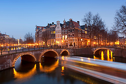 Evening view of bridges crossing the Keizersgracht,canal in Amsterdam The Netherlands