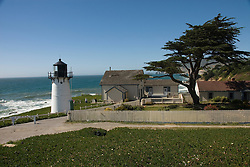Montara Lighthouse, now a Youth Hostel, .San Mateo Coast of California, south of San Francisco.  Photo copyright Lee Foster, 510-549-2202, lee@fostertravel.com, www.fostertravel.com. Photo 417-31188