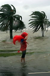 28 August 2012. New Orleans, Louisiana,  USA. <br /> Shana Fincher standsin flood water as Lake Pontchartrain crashes against the sea wall. Hurricane Isaac spins in the Gulf just waiting to come ashore. The 7th year anniversary of Hurricane Katrina is tomorrow and with a storm lurking in the Gulf many in the city are on edge.<br /> Photo; Charlie Varley